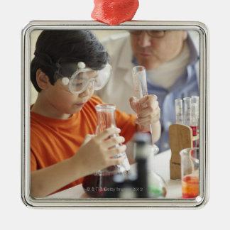 Boy (6-7) and teacher in chemistry class christmas ornament