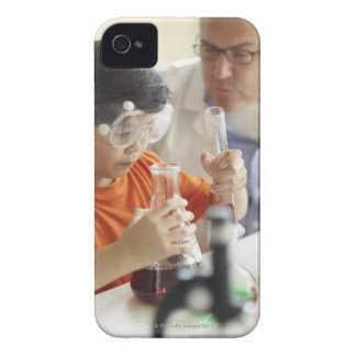Boy (6-7) and teacher in chemistry class iPhone 4 Case-Mate case