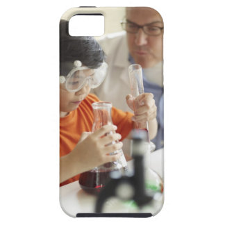 Boy (6-7) and teacher in chemistry class tough iPhone 5 case