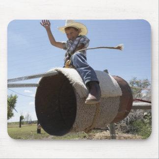Boy (8-10) riding makeshift rodeo bull mousepads