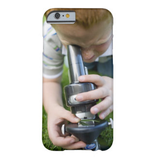 Boy (8-9) using light microscope, close-up barely there iPhone 6 case