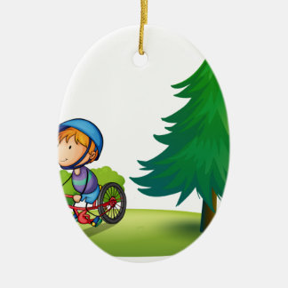 Boy and bike christmas ornament