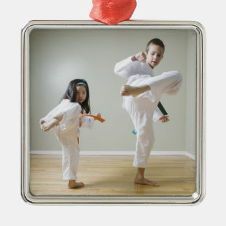 Boy and girl (4-9) practising Taekwondo kicks Silver-Colored Square Decoration