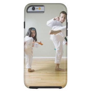 Boy and girl (4-9) practising Taekwondo kicks Tough iPhone 6 Case