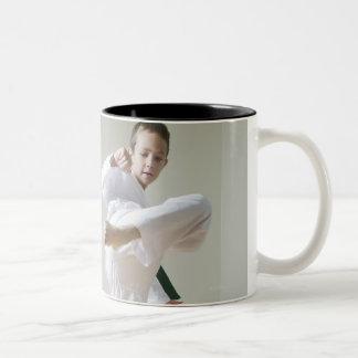 Boy and girl (4-9) practising Taekwondo kicks Two-Tone Coffee Mug