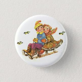 boy and girl playing ski 3 cm round badge