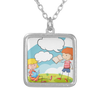 Boy and girl reading books in the park square pendant necklace