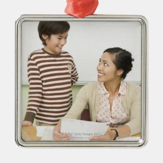 Boy and teacher at teachers desk Silver-Colored square decoration