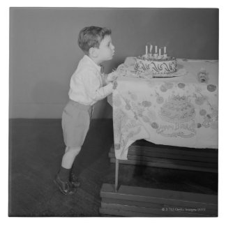 Boy Blowing Out Candles Tile