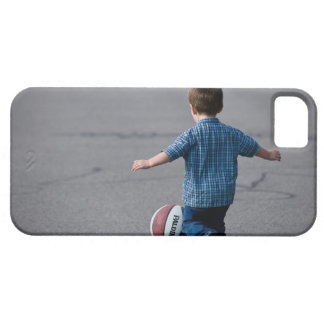 Boy chasing basketball outdoors iPhone 5 cover
