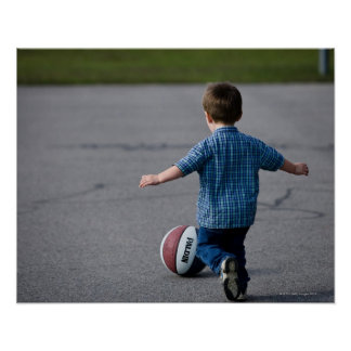 Boy chasing basketball outdoors poster
