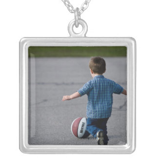 Boy chasing basketball outdoors silver plated necklace