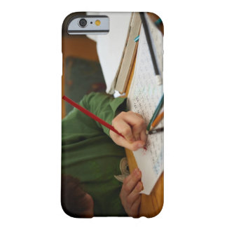 Boy concentrating on math homework barely there iPhone 6 case