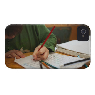 Boy concentrating on math homework iPhone 4 cases