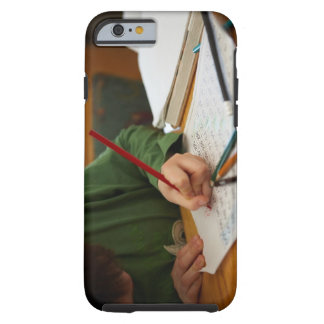 Boy concentrating on math homework tough iPhone 6 case