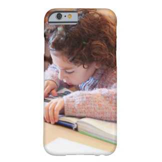 Boy concentrating on reading homework barely there iPhone 6 case