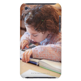 Boy concentrating on reading homework iPod touch cover