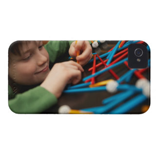 Boy connecting molecules for science project Case-Mate iPhone 4 case