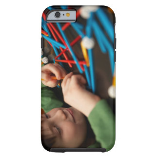 Boy connecting molecules for science project tough iPhone 6 case