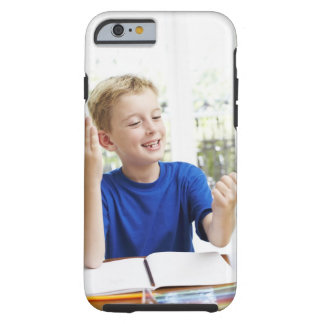 Boy counting on his fingers to complete his tough iPhone 6 case