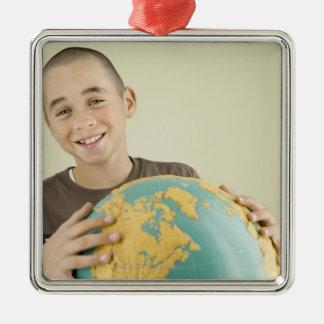 Boy holding globe christmas ornament