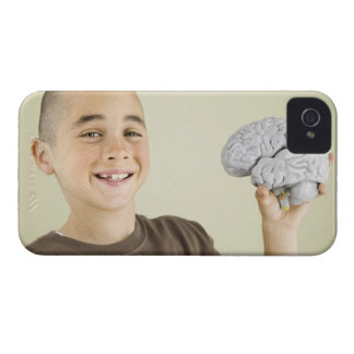 Boy holding human brain model iPhone 4 cases