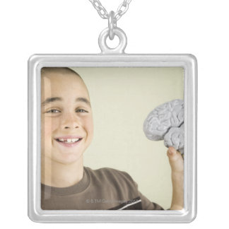 Boy holding human brain model silver plated necklace