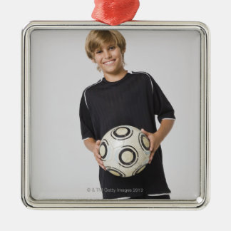 Boy holding soccer ball, smiling, portrait christmas ornament