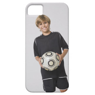 Boy holding soccer ball, smiling, portrait iPhone 5 case