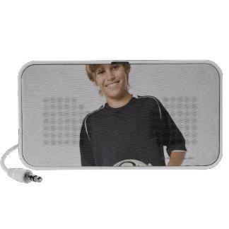 Boy holding soccer ball, smiling, portrait portable speakers