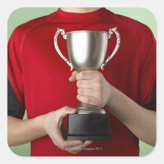 Boy Holding Trophy Square Sticker