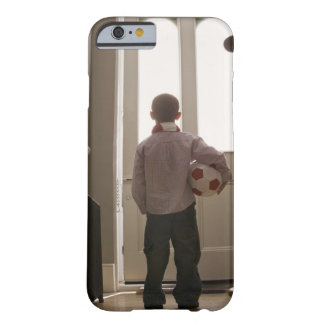 Boy in foyer with soccer ball barely there iPhone 6 case