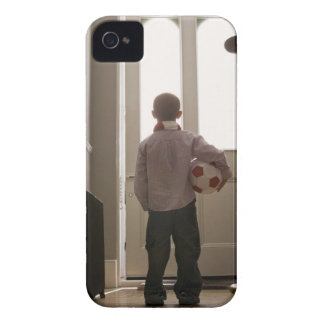 Boy in foyer with soccer ball Case-Mate iPhone 4 cases