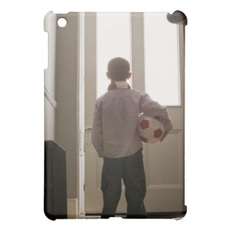 Boy in foyer with soccer ball cover for the iPad mini