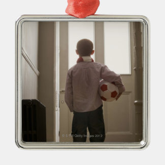 Boy in foyer with soccer ball Silver-Colored square decoration