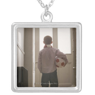 Boy in foyer with soccer ball silver plated necklace