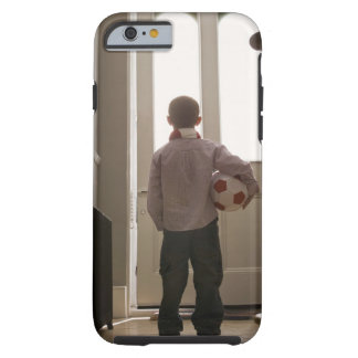 Boy in foyer with soccer ball tough iPhone 6 case