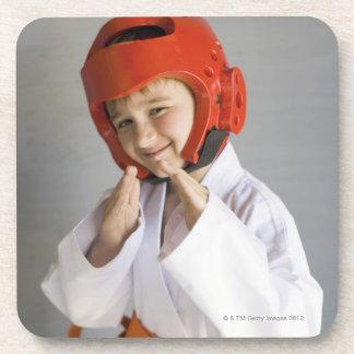 Boy in karate uniform wearing sparring headgear coaster