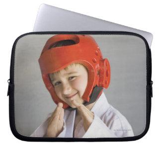 Boy in karate uniform wearing sparring headgear laptop sleeve