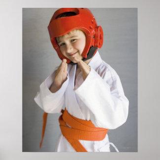 Boy in karate uniform wearing sparring headgear poster