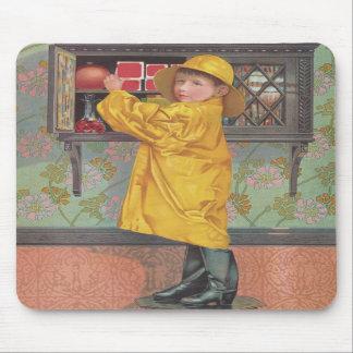 Boy in Raincoat Mousepads