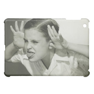 Boy Making Face Case For The iPad Mini