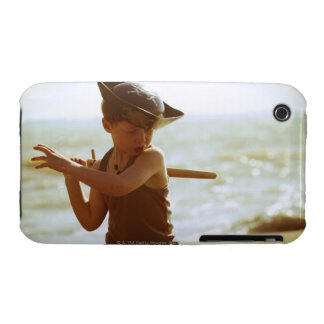 Boy playing pirate, wooden sword iPhone 3 covers