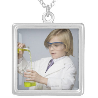 Boy pouring liquid into beaker silver plated necklace