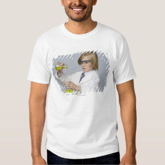 Boy pouring liquid into beaker t-shirts