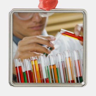 Boy pouring mixture from test tube christmas ornament