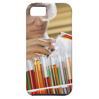 Boy pouring mixture from test tube iPhone 5 covers