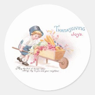 Boy Pushing Wheelbarrow of Harvest Thanksgiving Round Sticker