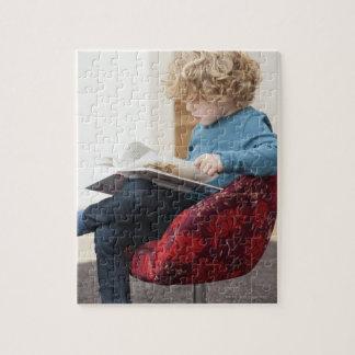 Boy reading a book jigsaw puzzle