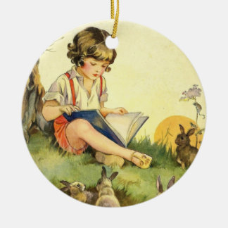 Boy reading under tree with rabbits christmas ornament